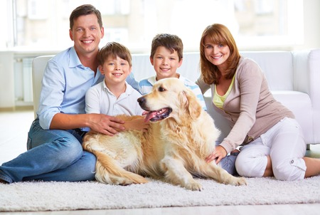 restful: Restful family members and Labrador sitting by sofa