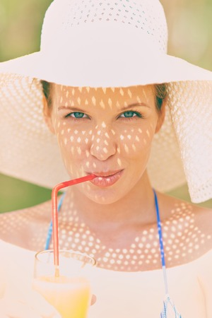 Portrait of a woman drinking juice in summer photo