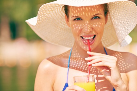 Portrait of a beautiful woman with drink photo