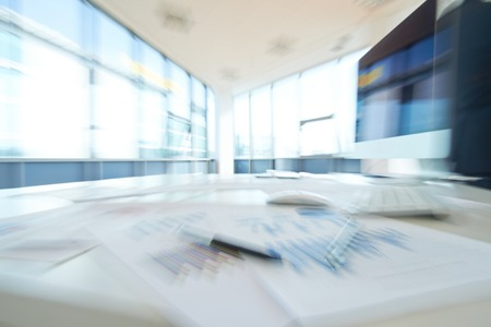 financial item: Blurred image of empty office