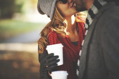 romantic kiss: Young people kissing outdoors