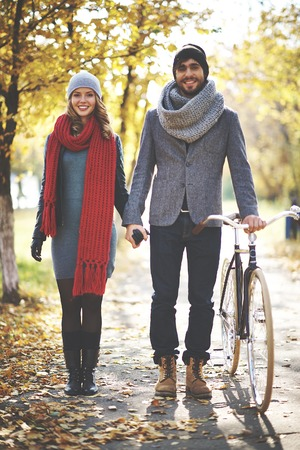 Portrait of young couple walking in autumn photo