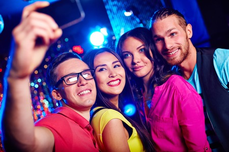 Young friends taking selfie photo