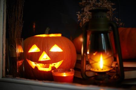 carved pumpkin: Halloween still life behind the window