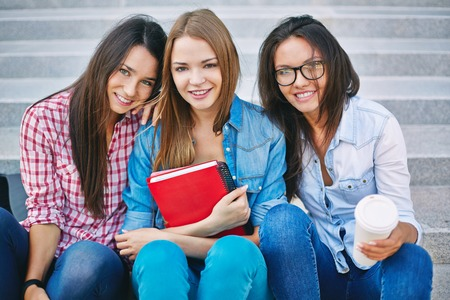 Portrait of three lovely female students photo