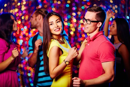 dancing club: Young couple dancing at nightclub Stock Photo