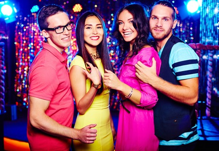 Portrait of two couples clubbing at night photo