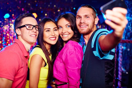 Young people taking selfie at nightclub Stock Photo