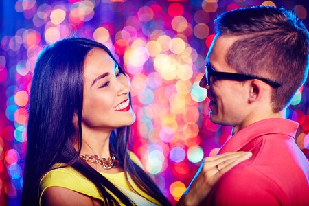 Portrait of a beautiful couple dancing at nightclub photo