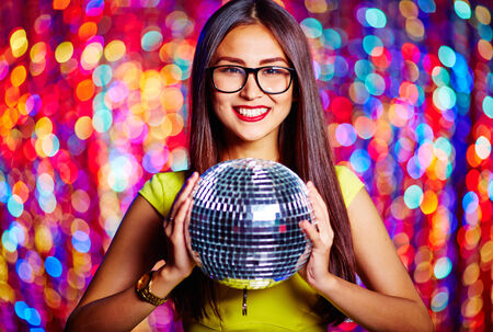 Portrait of a gorgeous girl with mirror ball photo