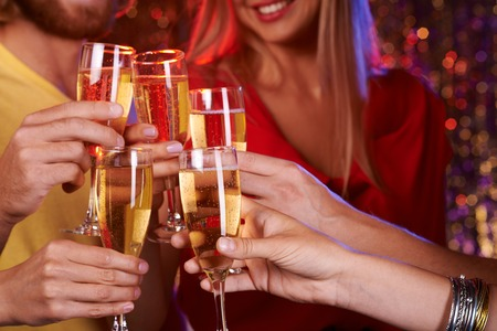 champagne flutes: Group of friends toasting with champagne Stock Photo