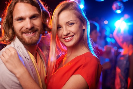 dancing club: Happy beautiful couple embracing at party Stock Photo