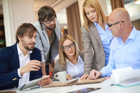 manager: Group of modern designers discussing new project Stock Photo
