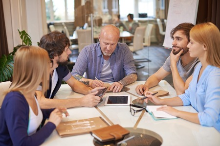 Group of creative business people having meeting in office photo