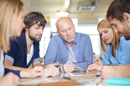 people working together: Group of pensive business people having meeting in office Stock Photo