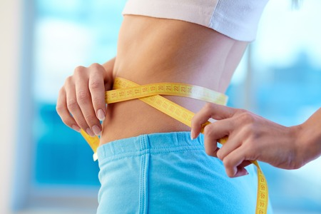 Taille van slanke vrouw in sportkleding Stockfoto