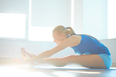 feminine beauty: Portrait of young woman doing stretching exercise