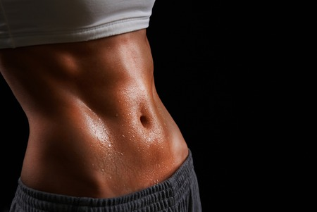 beautiful navel women: Wet torso of young sporty woman Stock Photo