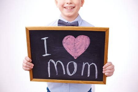 Small blackboard with love declaration held by a boy photo