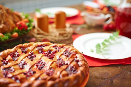 Homemade pie with cowberry jam on festive table Stock Photo