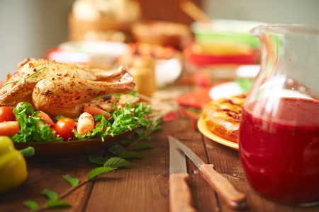 thanksgiving dinner: Roasted turkey with vegetables, berry drink and homemade pastry on festive table