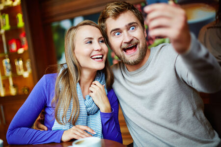 euphoric: Ecstatic young couple taking their selfie