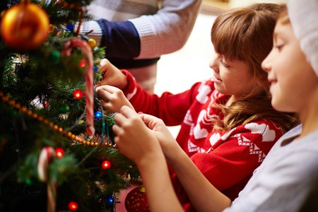 boys toys: Happy kids decorating Christmas tree for holiday