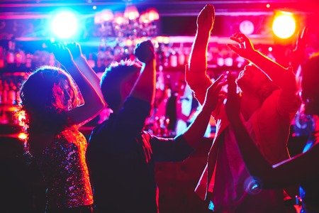 girl party: Group of dance lovers enjoying disco in nightclub Stock Photo
