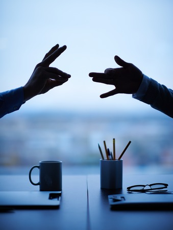 Hands of two businessmen outlining dog and rabbit