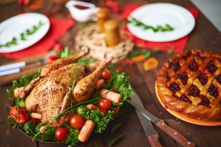 Homemade pastry and roasted poultry on festive table Stock Photo