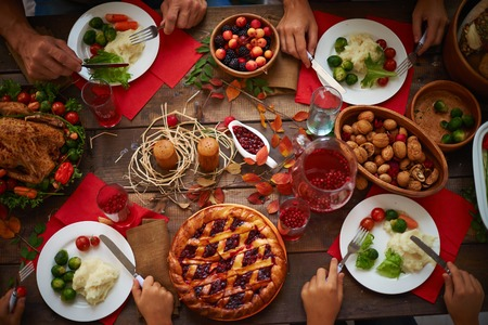 festive food: Hands of people over plates with festive food Stock Photo