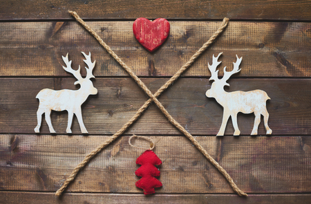 deer in heart: Wooden deer, heart, red fabric firtree and two ropes