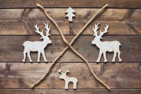 Wooden Christmas symbols and two ropes photo