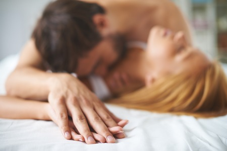 couple cuddling: Hand of man in that of a woman Stock Photo