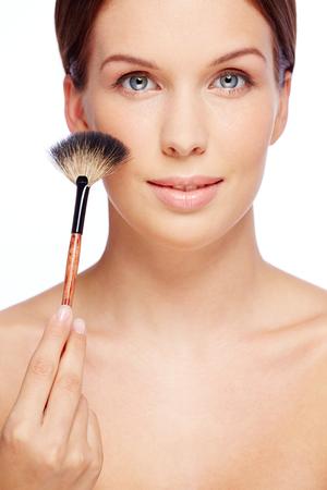 fresh girl: Fresh girl touching her cheek with powder brush Stock Photo