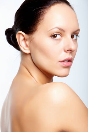 Gorgeous woman looking at camera in isolation photo