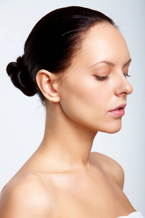 Fresh dark-haired woman over white  photo