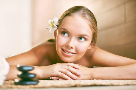 looking aside: Smiling girl looking aside while relaxing in beauty salon