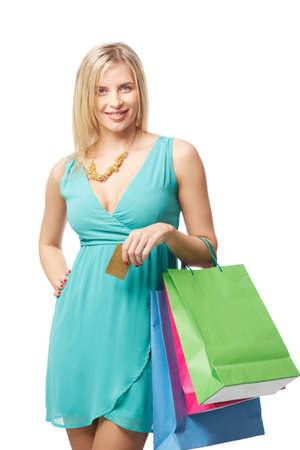 shopaholism: Attractive lady with multi-color paperbags and discount card looking at camera