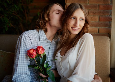 inlove: Portrait of amorous young man embracing his sweetheart and enjoying smell of her hair