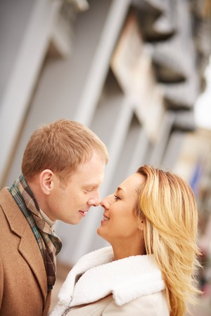 amorous woman: Amorous man going to kiss romantic woman Stock Photo