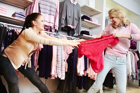 disinclination: Female shoppers fighting for the last tanktop in department store