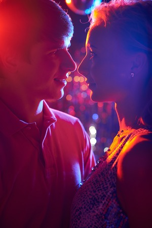 neon lights: Couple in neon lights Stock Photo