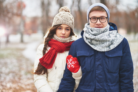 winterwear: Portrait of cute young dates in stylish winterwear looking at camera outdoors