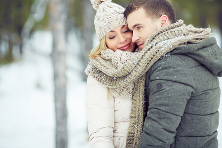 winter woman: Portrait of a young couple in warm clothing Stock Photo