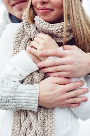girl bonding: Close-up couple embracing in woolen sweaters