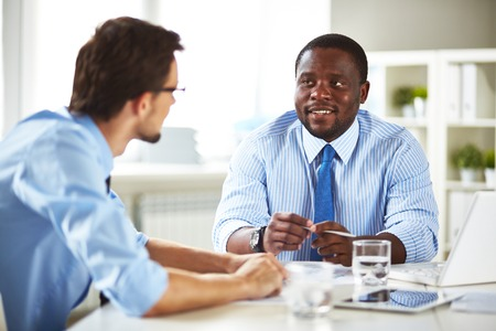 new employee: Businessman talking to a new employee