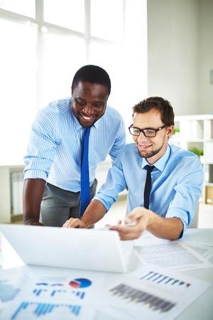 two men talking: Two men talking during work