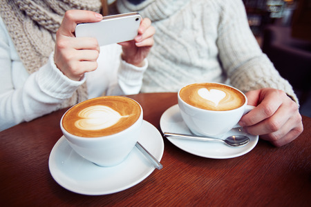 Close-up of two cups with latte photo