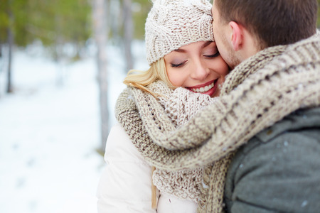 kissing love: Woman embracing with her boyfriend in winter